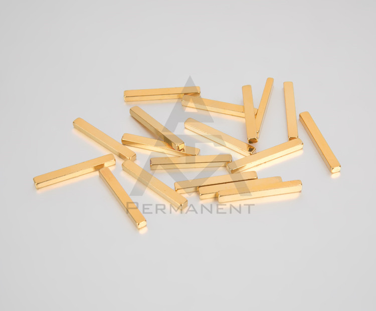 Bar magnet with gold coating